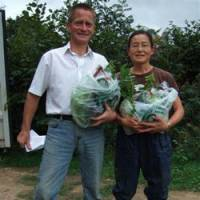 No additives: Robin and Ikuko Williams hold bags of organically grown Japanese vegetables at their farm in Sussex, England, on Sept. 10. | COURTESY OF ROBIN WILLIAMS