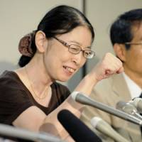 Fired up: Atsuko Muraki holds a news conference Wednesday at the Tokyo District Court before returning to work at the Health, Labor and Welfare Ministry. | KYODO PHOTO