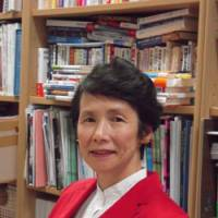 Giving youth a voice: Hitotsubashi University professor Yoko Ishikura is seen at her office at a recent interview with The Japan Times. | MIZUHO AOKI
