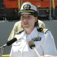 Touch and go: Andria Slough, commanding officer of the minesweeper USS Defender, addresses a press conference on Thursday. | KYODO PHOTO
