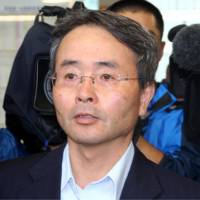 Widening probe: Hiromichi Otsubo, former chief of the special investigation department at the Osaka District Public Prosecutor's Office, is surrounded by reporters Thursday. | KYODO PHOTO