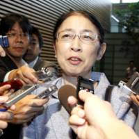 Back at work: Atsuko Muraki , appointed director general for policy planning at the Cabinet Office after being acquitted of fraud charges, speaks to reporters at the Prime Minister's Official Residence on Monday. | KYODO PHOTO
