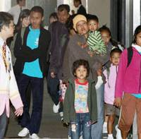 The promised land: Myanmar refugees arrive at Narita International Airport on Tuesday under the U.N.-promoted third country resettlement program. | KYODO PHOTO