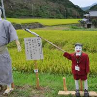 Scarecrow art: A skeleton (above) and a sumo wrestler are among some 100 scarecrows depicting social issues on display during a festival in Hasami, Nagasaki Prefecture.   KYODO PHOTO