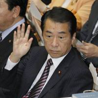 Feeling the heat: Prime Minister Naoto Kan responds to a question during a session of the Lower House Budget Committee on Thursday. | KYODO PHOTO