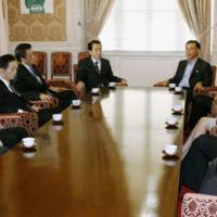 Political parlay: Prime Minister Naoto Kan and Liberal Democratic Party President Sadakazu Tanigaki (at far end of table) meet in the Diet with other executives of ruling and opposition parties on Sept. 21. | KYODO PHOTO