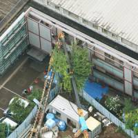 Counterpart needed: A toppled crane pokes into a third-floor room at the Pearl Daikanyama care home in Shibuya Ward, Tokyo, on Monday. No one was injured. | KYODO PHOTO