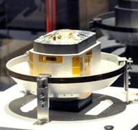 Not for popcorn: Scientists say extraterrestrial particles have been found in this capsule from the Hayabusa space probe, displayed at the Kintetsu department store in Osaka in September.   KYODO PHOTO