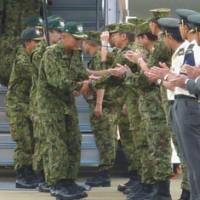 Home turf: Members of Japan's disaster relief team dispatched to flood-hit Pakistan return to Fukuoka airport Tuesday. | KYODO PHOTO