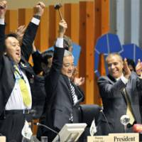 Nailed it: Environment Minister Ryu Matsumoto raises the hammer to end the COP10 conference in Nagoya on Saturday. | KYODO PHOTO
