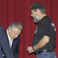On the hunt: Mayor Kazutaka Sangen (left) greets Sea Shepherd member Scott West on Tuesday before the first meeting ever in Taiji, Wakayama Prefecture, between local officials and foreign environmentalists. | AP PHOTO