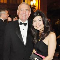In the news: Kyoko Gasha, a Reuters TV reporter, is seen with former CBS anchorman Dan Rather at the Front Page Awards organized by the Newswomen's Club of New York on Thursday. | KYODO PHOTO