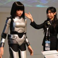Karaoke pal: Humanoid robot HRP-4C Miim, which can sing and dance, is introduced to journalists Wednesday at the International Media Center at the APEC conference venue in Yokohama.   SATOKO KAWASAKI PHOTO