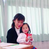 Happy time: Akemi Nakamura holds her 2-year-old daughter, Yuri, in Tokyo in December 2005, four days before the girl lost consciousness. | COURTESY OF AKEMI NAKAMURA