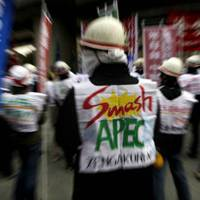 On a different page: Members of the leftist student group Zengakuren denounce the ongoing APEC meeting in Yokohama during a protest Saturday. | AP PHOTO