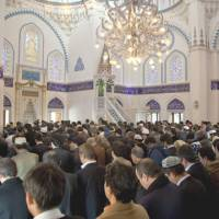 Keeping the faith: Muslims worship in the prayer hall of the Tokyo Camii & Turkish Cultural Center in Shibuya Ward. Tokyo Camii is Japan's second-oldest mosque, having been originally built in 1938.   COURTESY OF TOKYO CAMII & TURKISH CULTURAL CENTER