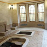 The Roman-style bathing room is decorated with stained glass windows.