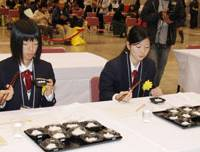 Taste testers: High school students in Matsue, Shimane Prefecture, try out different varieties of rice Sunday in the first national competition among rice-growing high school students. | KYODO PHOTO