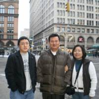 Happier days: Hoon 'Scott' Kang is seen with his parents in New York City in late 2009. Kang, 19, was found unconscious in Tokyo in late August in the emergency stairwell of a building in Shinjuku Ward's seedy Kabukicho district. | COURTESY OF SUNG WON KANG