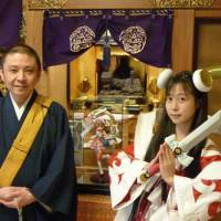 Nakazato and singer Toromi, dressed as the anime character Toro-Benten, which is based on the goddess Benzaiten, stand in front of a figurine of the character at Ryohoji.