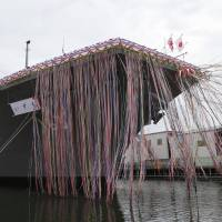 On the defensive: The Maritime Self-Defense Force's newest warship, the DDH183 Izumo, is launched at a ceremony in Yokohama on Tuesday. | KYODO