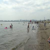 Wade in: Visitors enjoy Kasai Rinkai Park's beach, the first natural Tokyo beach opened to swimming in 51 years. | JUN HONGO