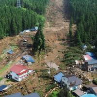 Aftermath: A landslide that crashed into the community of Tazawako Tazawakuyobutsu in Senboku, Akita Prefecture, killing three people and leaving two others missing, is seen Saturday. | KYODO