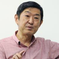 Defense matters: Shinichi Kitaoka, president of the International University of Japan and acting chairman of a government panel on security issues, is interviewed Tuesday. | KYODO