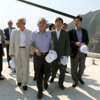 Tricky trip: Kim Han-gil (center), head of South Korea's Democratic Party, and other party members visit the Takeshima Islands, called Dokdo and controlled by Seoul, on Tuesday. | YONHAP NEWS AGENCY/KYODO