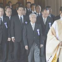 Tight formation: Members of a nonpartisan Diet group that advocates visits to war-linked Yasukuni Shrine are escorted by a Shinto priest inside the shrine in Tokyo's Chiyoda Ward Thursday, the 68th anniversary of Japan's surrender in World War II. | KYODO