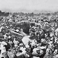 Scenes of chaos: Survivors of the Sept. 1, 1923, Great Kanto Earthquake gather shortly afterward in the plaza in front of the Imperial Palace in central Tokyo. Based on the original panoramic shot taken by the Hochi Shimbun, an association to commemorate the victims has reproduced a large photo panel for exhibit ahead of the quake's anniversary next month. | TOKYO IREI KYOKAI/KYODO