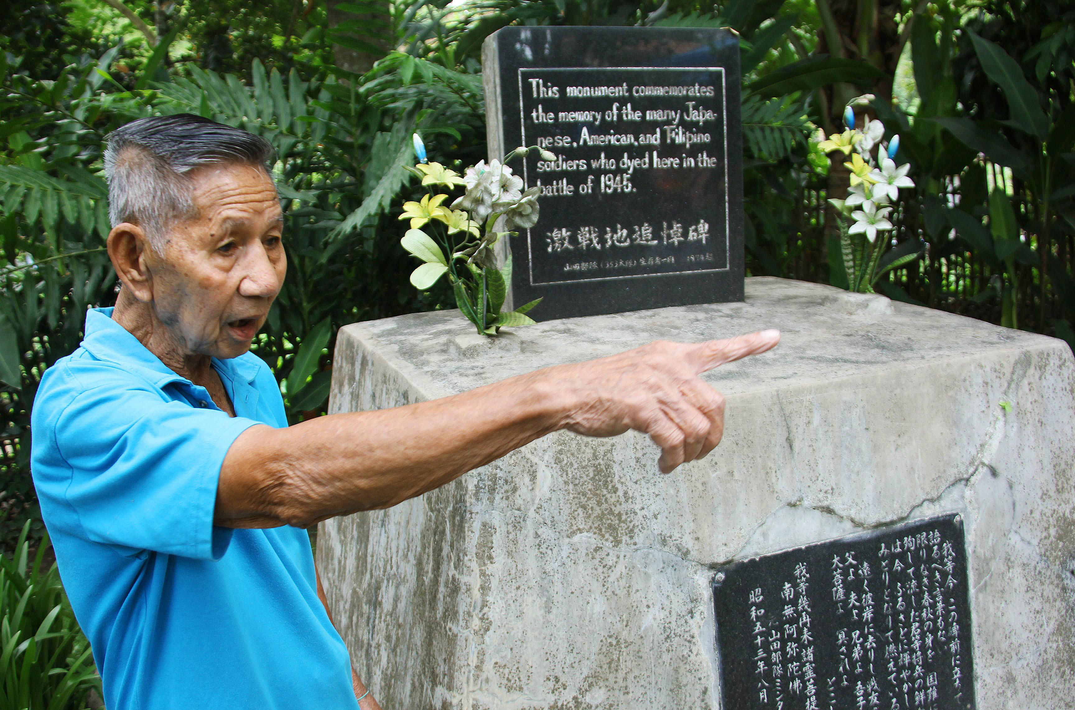 Memorial: Japanese-Filipino Koichi Sakae on Aug. 10 shows off a monument at his home in Davao that is dedicated to Japanese, American and Filipino soldiers who died in the war. | KYODO