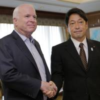 Hand in glove: Visiting U.S. Sen. John McCain (left) and Defense Minister Itsunori Onodera pose for a photograph prior to their meeting at the Defense Ministry on Wednesday. | AP