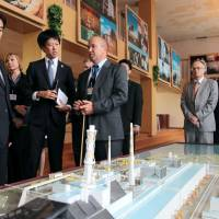 Reality check: Foreign Minister Fumio Kishida (left) is briefed on the status of the Chernobyl nuclear power plant during his visit to Ukraine on Sunday.   KYODO
