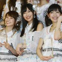Left to right: Yuko Oshima, Rino Sashihara and Mayu Watanabe pose June 8 after being selected as the top three members of pop idol group AKB48 and its sister groups in an election at a stadium in Yokohama. | KYODO