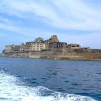 'Battleship Island': Nagasaki Prefecture's uninhabited Hashima Island, which was a thriving coal mining facility from the late 19th century to the mid-1970s, was picked Tuesday by a government panel for possible inclusion on the UNESCO World Heritage list in 2015. | KYODO