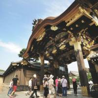 Portal to the past: Visitors walk through the Karamon gate at Nijo Castle in Nakagyo Ward, Kyoto, on Wednesday after it was opened to the public following renovation work. | KYODO