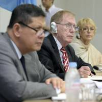 Sympathetic ears: Members of the U.N. Commission of Inquiry on Human Rights in North Korea (from left) Marzuki Darusman, Justice Michael Kirby and Sonja Biserko listen to relatives of Japanese abducted by North Korean agents during a two-day public hearing in Tokyo at U.N. University on Thursday. Right: Sakie Yokota (second from left) speaks about her abducted daughter, Megumi. | KYODO