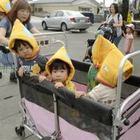 Nursery school students and teachers head to an evacuation area during a disaster drill held in Yamamoto, Miyagi Prefecture, on Saturday.   KYODO