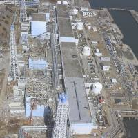 Early days: The Fukushima No. 1 plant is seen on March 24, 2011, as the meltdown crisis triggered by the quake and tsunami 13 days earlier rapidly escalated.  | AIR PHOTO SERVICE/AP