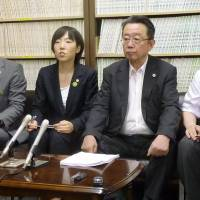 Lawyers sue for lawyers: Lawyers representing some 200 former legal apprentices who sued the government attend a press conference in Nagoya on Friday.  | KYODO