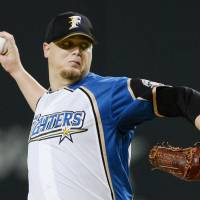 Fighters pitcher Wolfe not ready to give up on season
