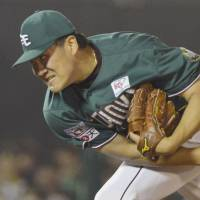 Looks invincible: Eagles right-hander Masahiro Tanaka fires a pitch during his seven-inning outing against the Hawks on Friday at Kleenex Stadium. Tanaka improved to 16-0 on the season, helping Tohoku Rakuten defeat Fukuoka Softbank 5-0 in the series opener. | KYODO