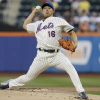 Pounded: New York's Daisuke Matsuzaka pitches against Detroit in the first inning on Friday night. The Tigers beat the Mets 6-1.   AP