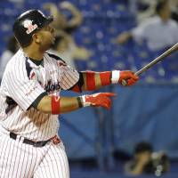 And away it goes: The Swallows' Wladimir Balentien watches his 49th home run of the season, a three-run shot in the second inning, sail into the stands at Jingu Stadium on Tuesday against the Dragons. Balentien had two homers in Tokyo Yakult's 10-8 loss to Chunichi. | KYODO