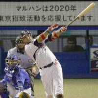 Chasing history: Swallows slugger Wladimir Balentien hits his 52nd home run of the season in the fourth inning against the BayStars on Friday at Jingu Stadium. Tokyo Yakult routed Yokohama 8-2. | KYODO