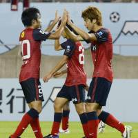 You did it: Yuya Osako, right, celebrates with a teammate during Kashima's win over Sao Paulo on Wednesday. | KYODO