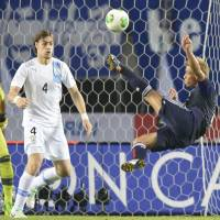 Best foot forward: Keisuke Honda takes a shot during Japan's 4-2 loss to Uruguay in an international friendly on Wednesday. | KYODO