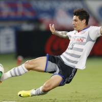 Team effort: Marquinhos boots the ball for Marinos during Saturday's match against FC Tokyo. Yokohama triumphed 2-0 and returned to the top of the J.League table. | KYODO