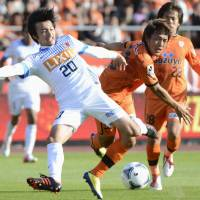 On the right track: Kashima Antlers midfielder Gaku Shibasaki (left) has earned accolades for his dedication and ability during his short time in the J. League. | KYODO